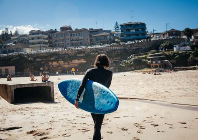 grom (kid) heading out surfing